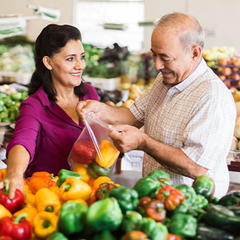 Caregiver and senior client buying groceries